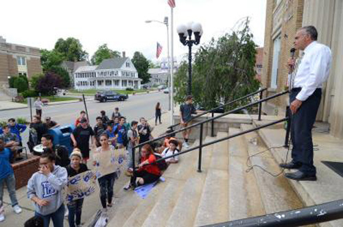 Leominster High School students protest faculty and staff layoffs with walkout, march to City Hall